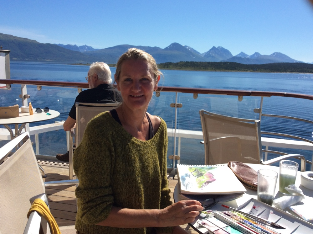 The Artist, Pauline Williams, painting the spectacular mountains of the Arctic Circle.